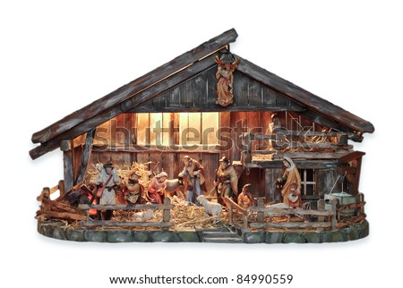 isolated nativity scene in a wooden creche - stock photo