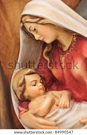 isolated nativity scene; Josef and Mary with the young Jesus Christ in her arms - stock photo