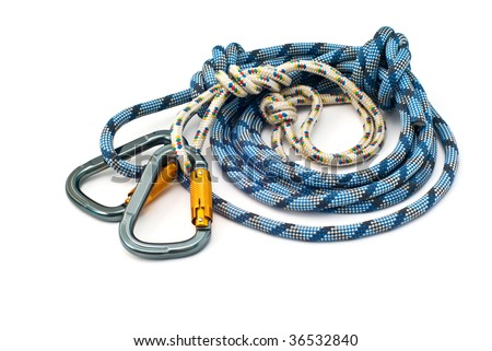Isolated new climbing equipment - carabiners without scratches and blue rope - stock photo