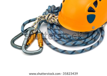 Isolated new climbing equipment - carabiners without scratches, orange helmet and rope - stock photo