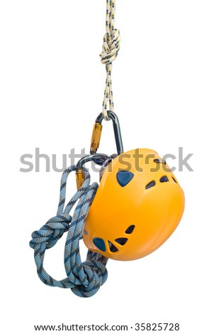 Isolated new climbing equipment - carabiners without scratches, yellow helmet and rope - stock photo