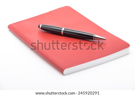 Isolated notepad or notebook with ballpoint pen for jotting down ideas and business plan on white background - stock photo