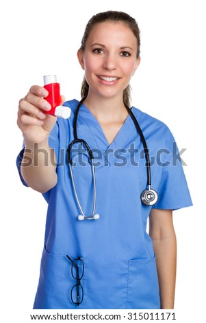 Isolated nurse holding asthma inhaler - stock photo