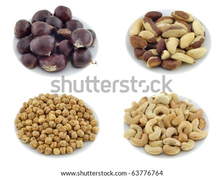 Isolated nuts and appetizers on white plate - stock photo