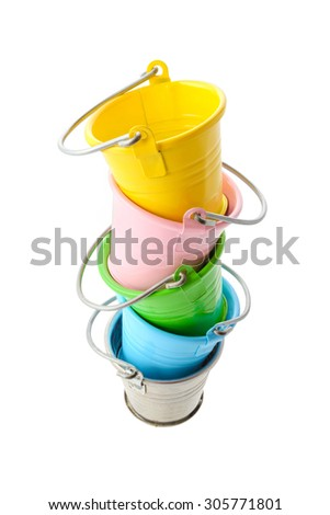 Isolated objects: colorful buckets, stacked vertically, isolated on white background - stock photo