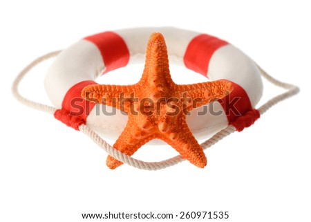 Isolated objects: still life with orange starfish and white-red lifebuoy, isolated on white background - stock photo