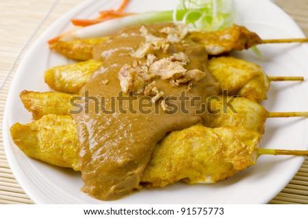 Isolated of delicious Thai chicken satay - stock photo