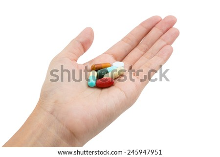 Isolated of Hand holding various types of drugs.