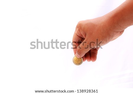 Isolated of hand putting a coin concept - stock photo