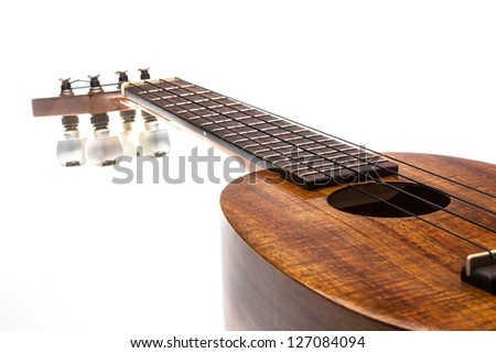 Isolated of pineapple shape ukulele on the white background
