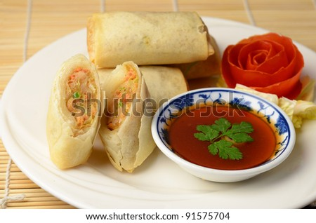 Isolated of vietnamese spring rolls with sweet chilli dip sauce.
