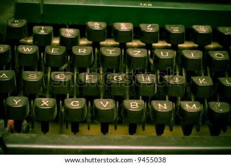 Isolated old dusty typewriter keyboard - stock photo