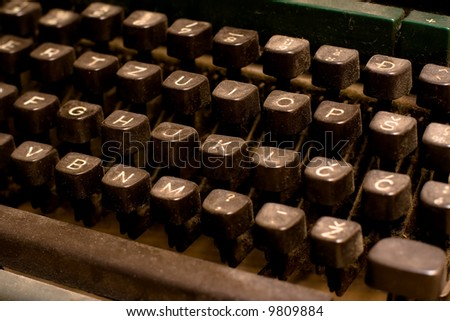 Isolated old dusty typewriter keyboard. author and copyright concept - stock photo