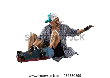 Isolated old man skater on the white background - stock photo