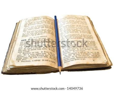 Isolated old open book with pencil against the white background
