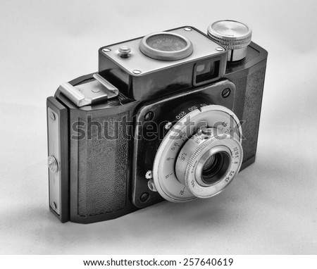 Isolated old retro photo camera - stock photo