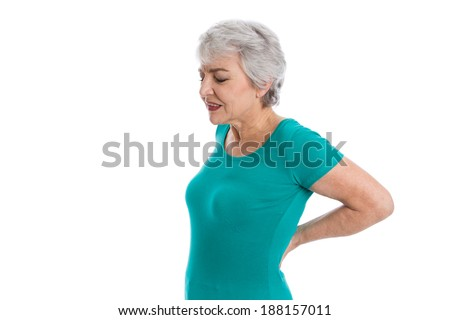 Isolated older woman with backache. - stock photo