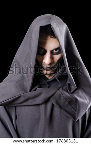 Isolated on black dark guy portrait costume - stock photo