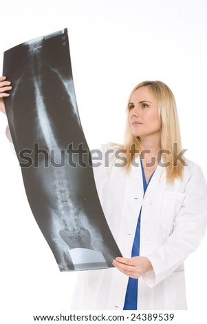 isolated on white a doctor analyze a radiography - stock photo