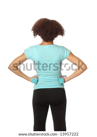 Isolated on white back view of a female athlete looking at copy space