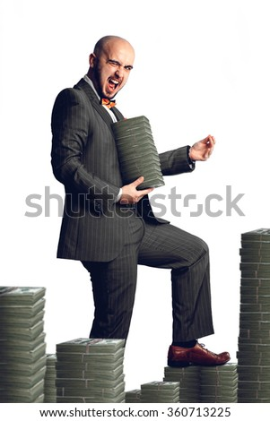 Isolated on white background rich man in an expensive suit with a bunch of money around and in the hands. Business concept - stock photo
