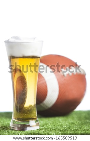 Isolated on white beer and american football ball  - stock photo