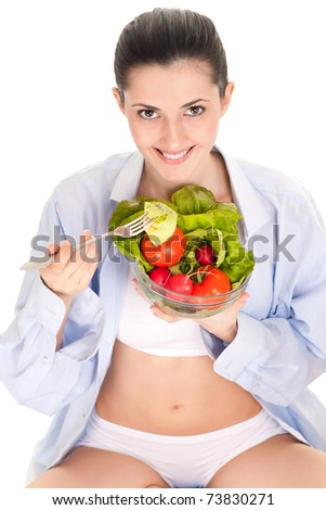 isolated on white, breakfast, female eating her salad - stock photo