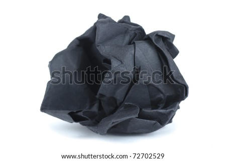 isolated on white crumpled black paper into a ball - stock photo