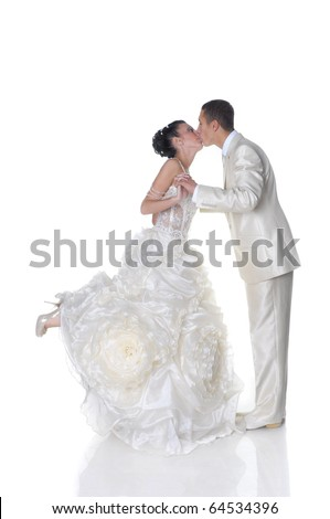 Isolated on white kissing bride in wedding dress and groom