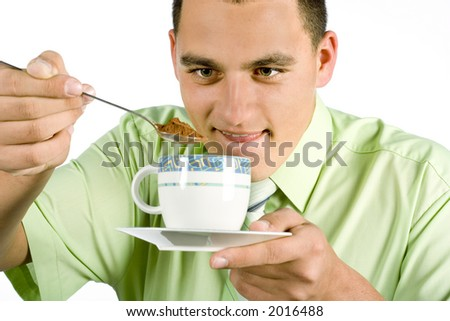 isolated on white man with  spoon and cup going to make hot drink - stock photo