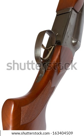 Isolated on white, part of a hunting rifle and the trigger