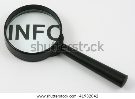 Isolated on white: sign INFO through magnifying glass on the white background