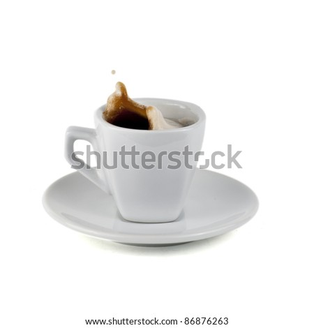 Isolated on white splashing cup of coffee - stock photo