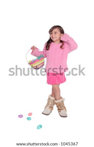 isolated on white this cute girl with her Easter basket and a few dropped eggs