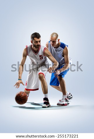 Isolated on white  two basketball players in action - stock photo