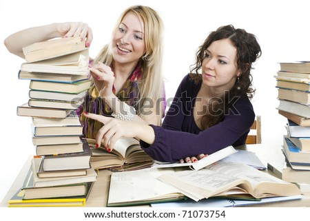 isolated on white two girls with books on the table