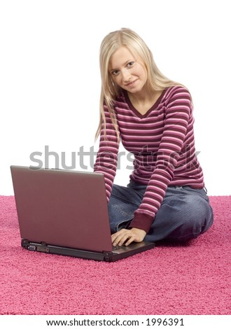 isolated on white young blonde woman sitting on the pink carpet with laptop - stock photo