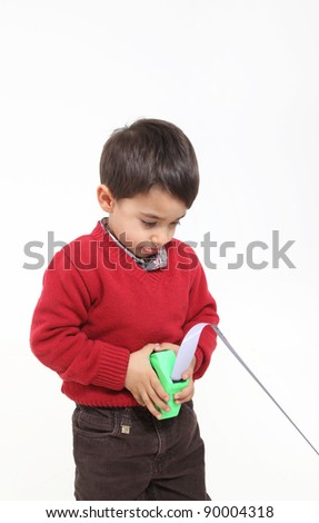 Isolated on white young boy play with meter - stock photo