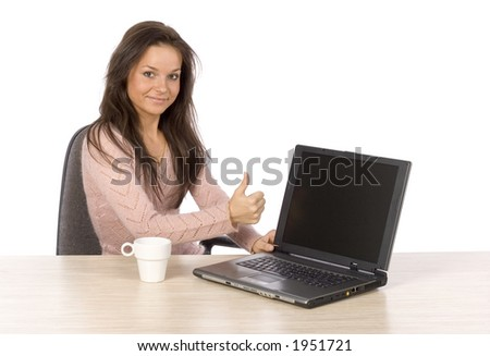isolated on white young woman at the desk with laptop showing OK - stock photo