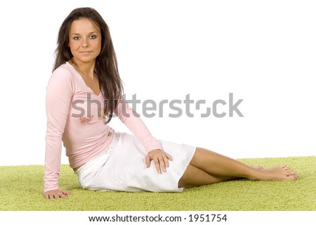 isolated on white young woman sitting on the green carpet - stock photo