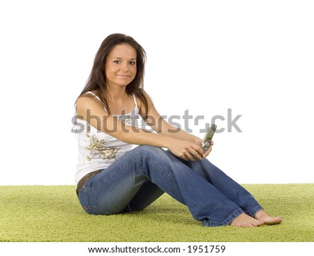isolated on white young woman with cell phone on the green carpet - stock photo
