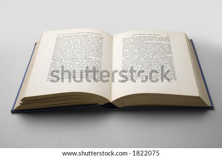 Isolated open book over a light grey background