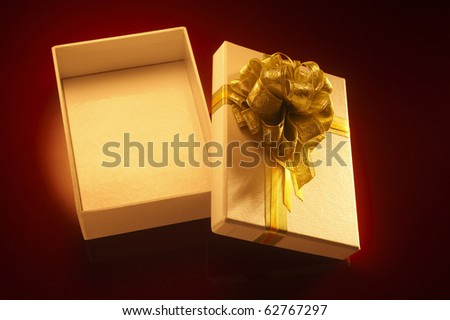 Isolated open gift box with gold ribbon - stock photo