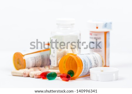 Isolated Orange Prescription Medication Bottles with Pills - stock photo