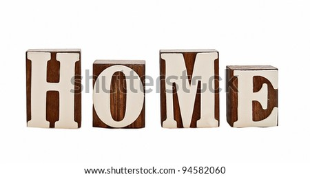 isolated over white, rough wooden blocks spelling the word home (intentionally grungy)