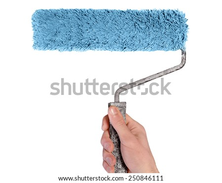 Isolated paint roller in male hand - stock photo