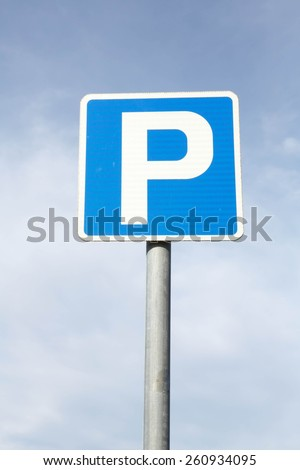 Isolated Parking Sign - Blue road sign with letter P on rectangular plate isolated against a blue sky. - stock photo