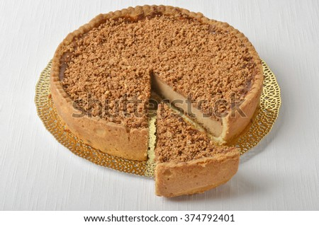 Isolated Pecan pie and slice on the table