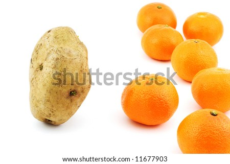 Isolated photo of confrontation between potato and mandarins