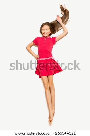 Isolated photo of cute girl in red dress with long hair lying on floor - stock photo